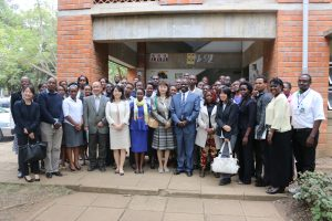 Prof. Odhiambo and Ms. Kishimoto take a photo with the 44 trainees and their instructors