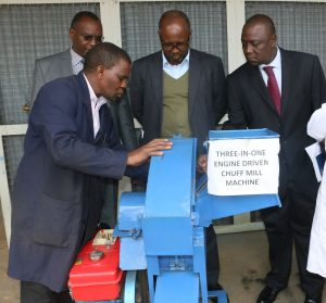 AfDB's Financial Sector Development Programme Manager, Robert Musambuko (second right), Director, Africa Financial and Technical Assistance, Nixon Nixon Bugo (right) view Chuff Mill Machine developed by JKUAT when the two visited the University
