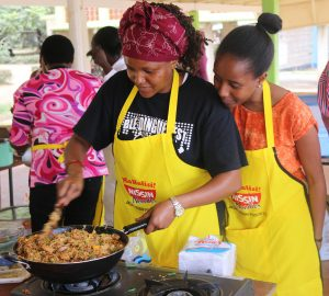 Joyce Mugo, a post-grduate Food Science student, prepare a dish of JKUAT-Nissin noodles during a food expo at the University