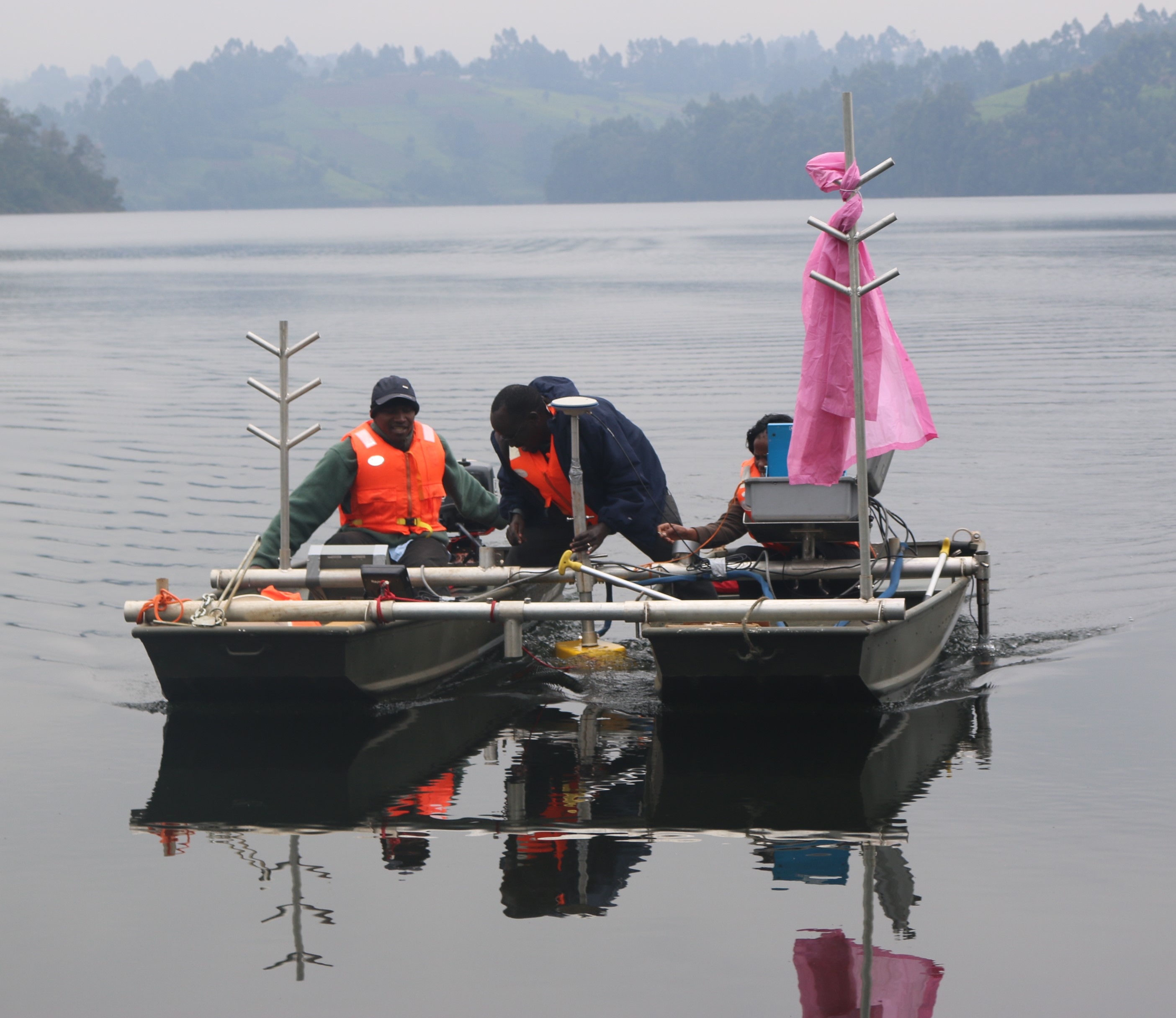 Dr. Joseph Sang (centre) leads other researchers during bathymetric survey of Ndakaini Dam