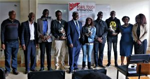 Members of the winning team take a photo with Prof. Odhiambo, Fuculty members and CEOs of the industry partners