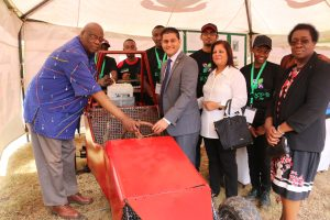 Prof. Maloiy (left), Mr. Chandaria (Center) and Prof. Imbuga (right) pose with the innovators of the JKUAT Race Car