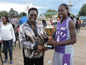 Molly receives the maiden KUSA National Basketball Tournament winners trophy.
