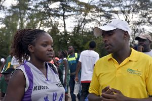 Coach Kimani interacts with one of his players