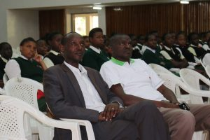 Prof. Ikua (right) and Dean School of Mechanical, Manufacturing and Materials Engineering, Dr. Hiram Nderitu follow a presentation during the forum.