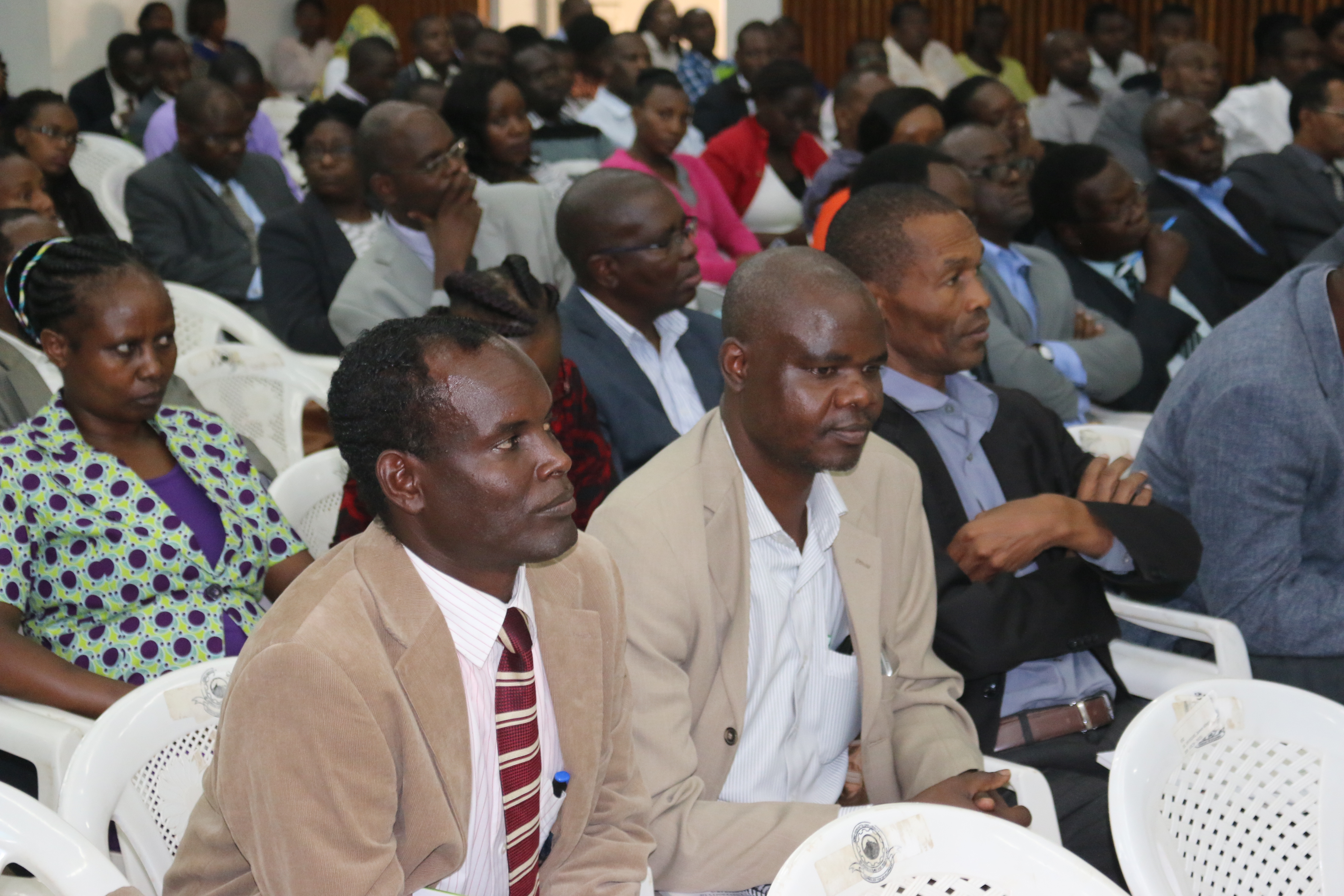 Participants follow the proceedings during the exit seminar