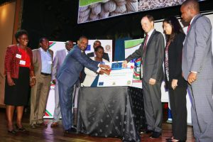 Mr. Mohamed (front left), Prof Imbuga (centre) and Mr. Habers cut the ribbon to signal the launch of the food fortification programme