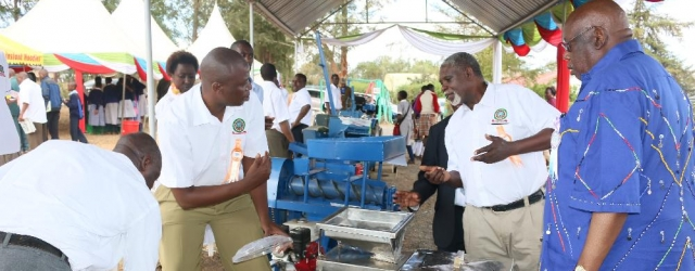 Chancellor Prof Maloiy interacting with exhibitors at the engineering workshops.