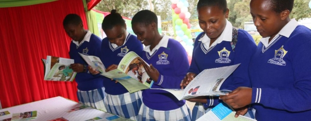 Students from St. Cathriene of Siena Mugunda Girls perusing some of the corporate publications at the JKUAT Stand during the 2017 Central Kenya Show.