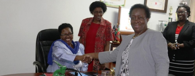 Vice Chancellor, Prof. Victoria Ngumi takes over the reigns from Prof. Mabel Imbuga as witnessed by Council Member, CPA Bertha Dena (2nd left) during the handover ceremony.