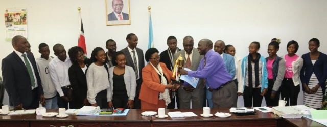 JKUAT Choir team present a trophy they recently won during the 2019 National Music Festival to Vice Chancellor Prof. Victoria Wambui Ngumi and the University Management Board